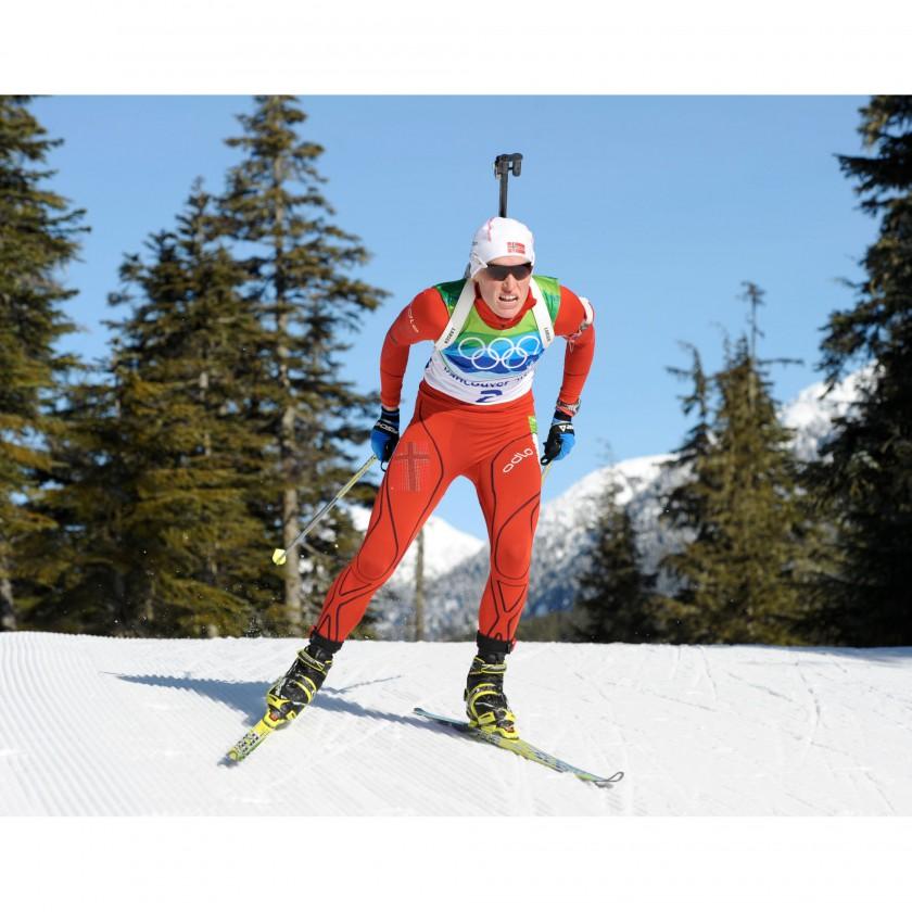 Photo: NordicFocus - Tora Berger gewinnt eine Goldmedaillen bei Olympia 2010 im Biathlon